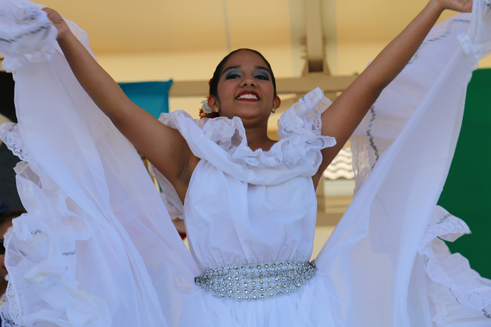 one female dancer in white dress holding up sides