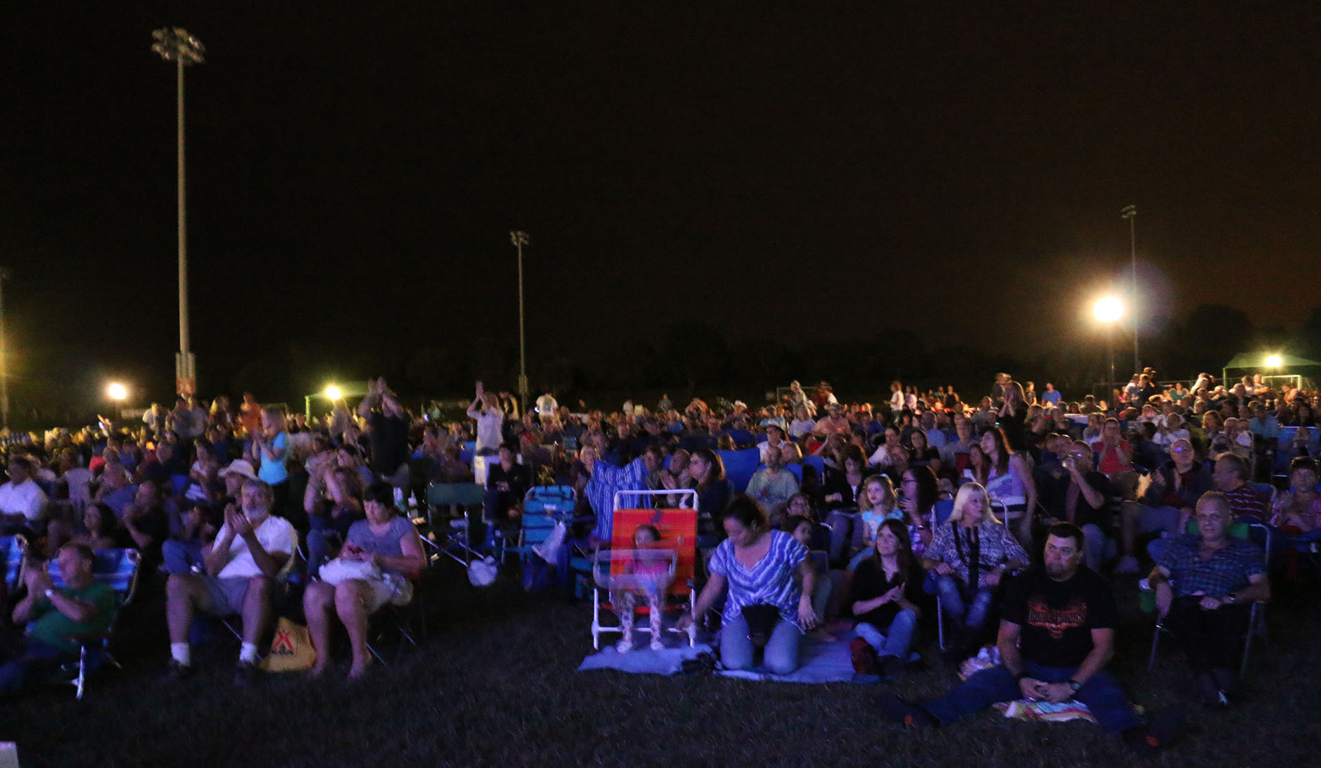 audience at outdoor concert in the park