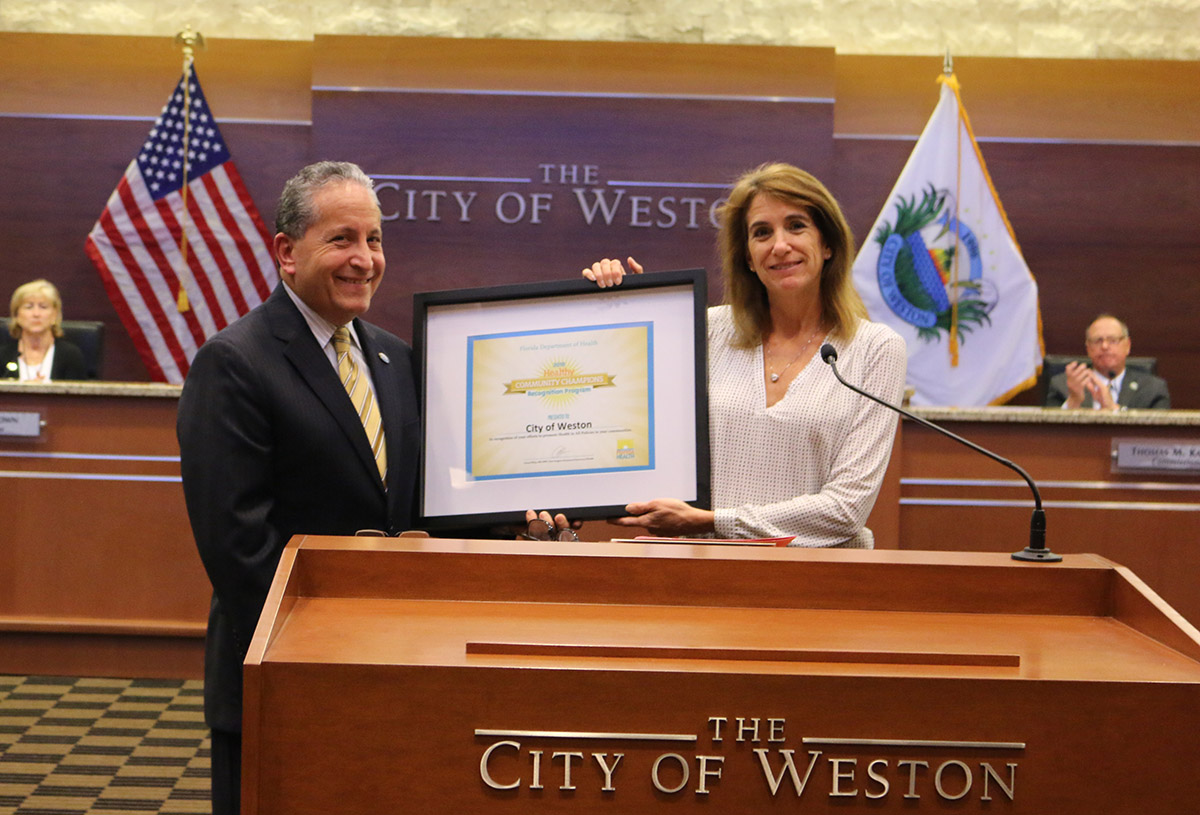 Mayor presented with Healthy Weight Community plaque by Health Director